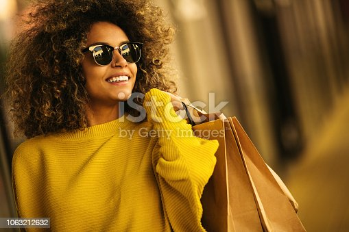 Beautiful female walking and shopping in mall