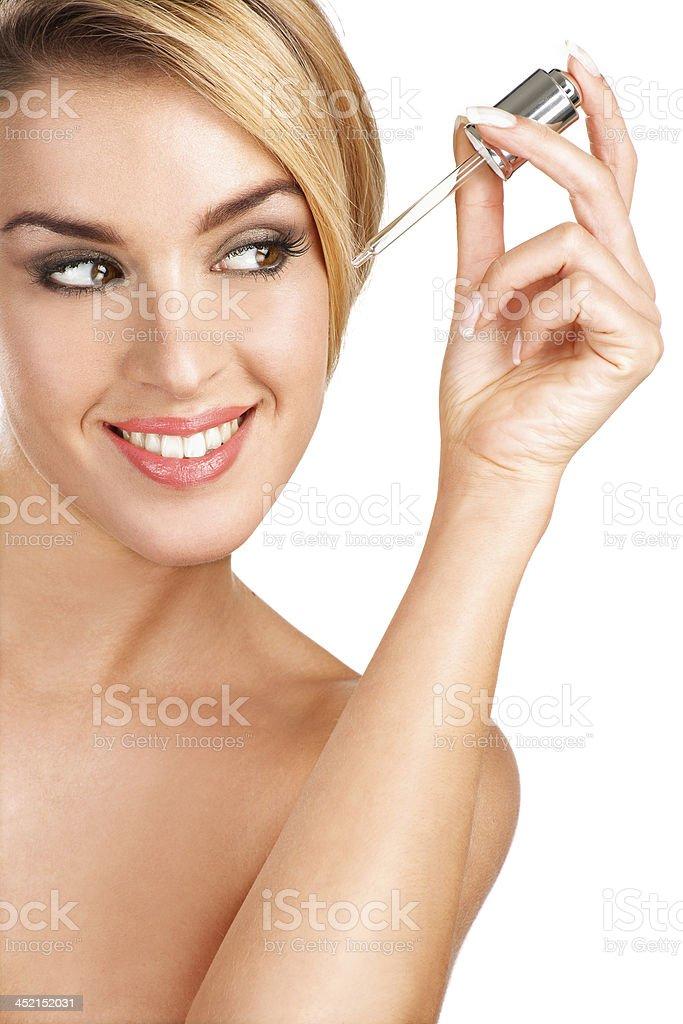 beautiful model applying a skin serum treatment stock photo