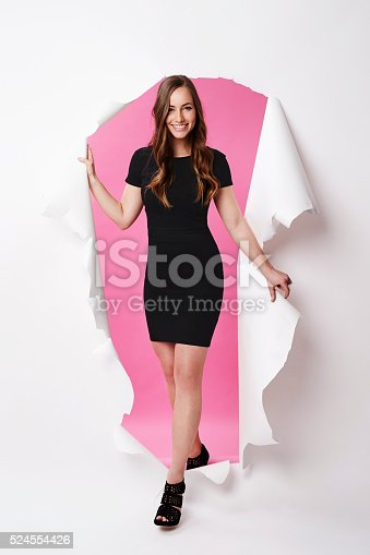 istock Beautiful model emerging in studio, portrait 524554426