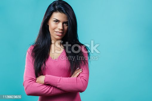 istock beautiful model with Ameriacn appearance posing to the camera with crossed arms 1126623620