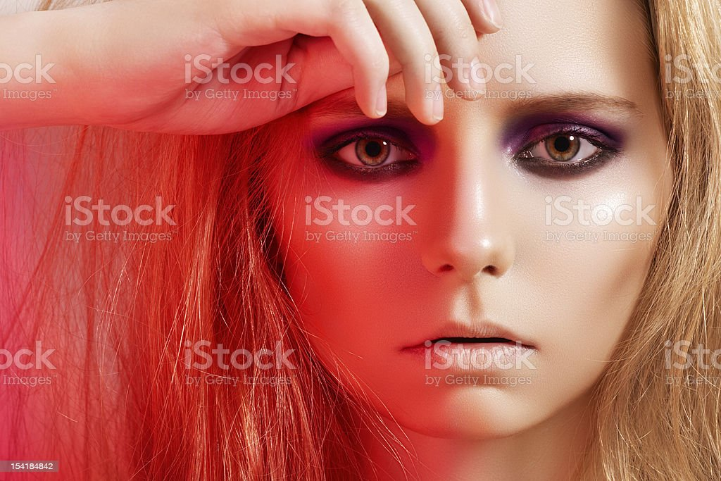 Beautiful model with fashion make-up in red light stock photo