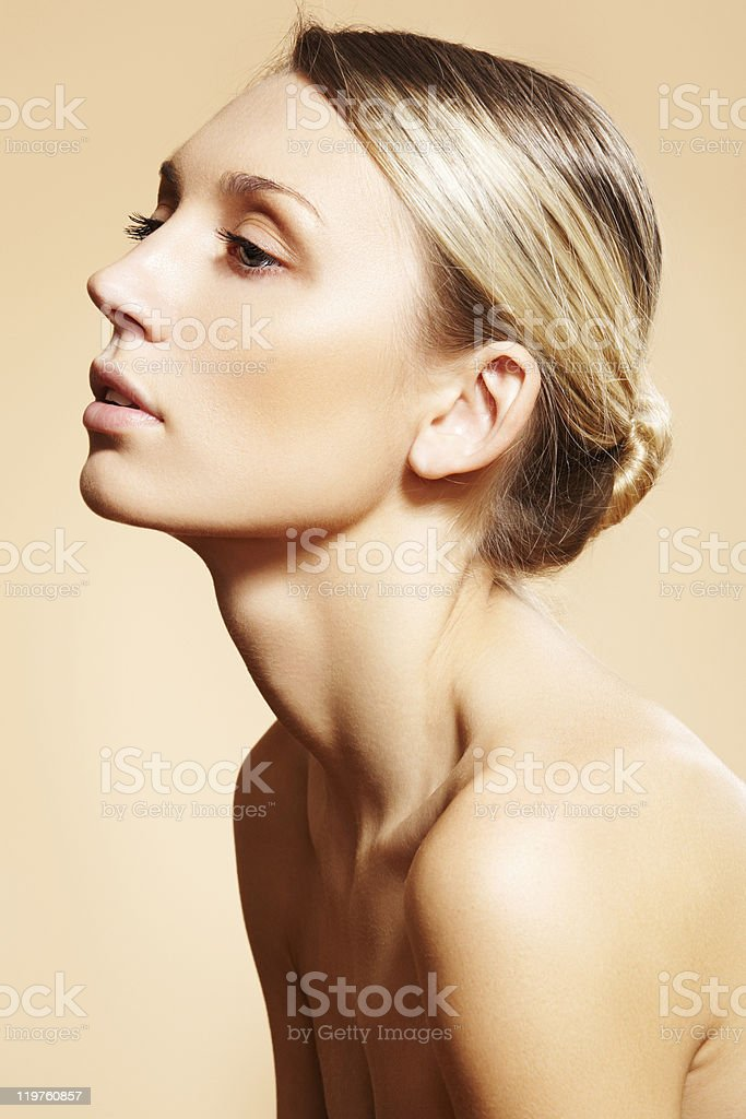 Beautiful model with natural make-up, clean skin, blond hair bun stock photo