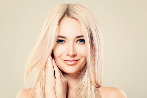 Beautiful Model Woman with Healthy Skin and Blonde Hair. Cute Female Face. Spa Beauty, Facial Treatment and Cosmetology Concept stock photo