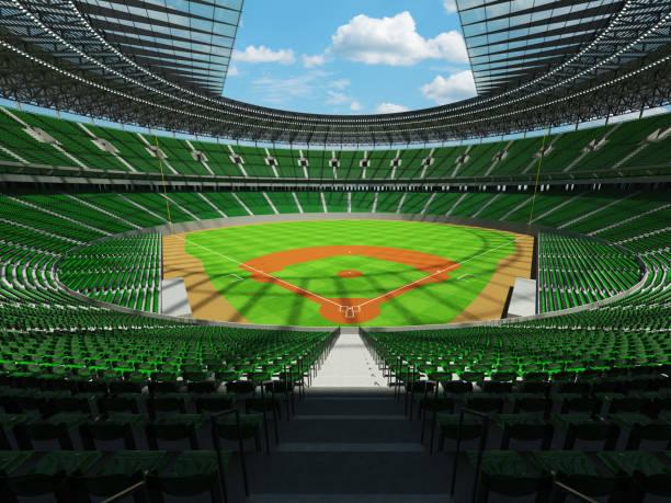 Beautiful modern baseball stadium with green seats and VIP boxes stock photo
