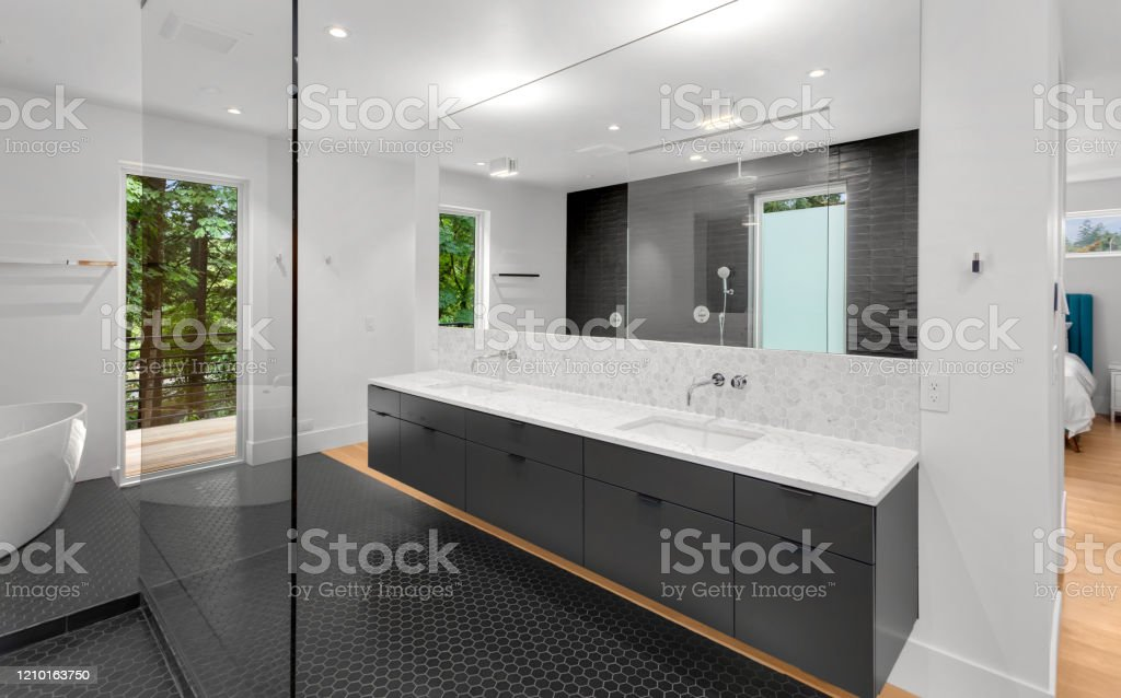 Beautiful Modern Bathroom Interior In New Luxury Home With Double Vanity Mirror And Cabinets Stock Photo Download Image Now Istock