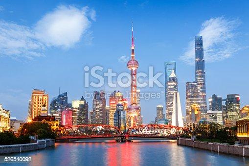 istock Beautiful modern city at night in Shanghai, China 526540092