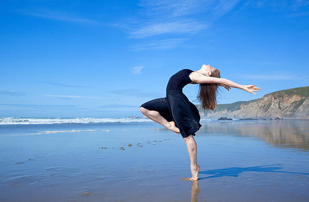 beautiful modern dancer at the beach stock photo