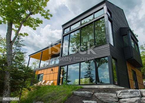 istock Beautiful modern house in the forest, outdoor 480288634