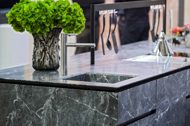 beautiful modern kitchen design, kitchen faucet and kitchen decor, gray marble kitchen island - kitchen counter imagens e fotografias de stock