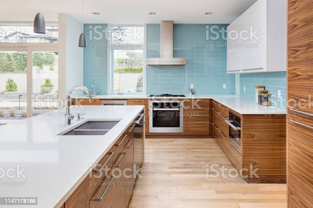 Beautiful modern kitchen in new contemporary style luxury home with picture id1147178166?b=1&k=6&m=1147178166&s=612x612&h=osqujs ofuis9uw6wujvuz1xjdojmg9yhkkyv97bybo=