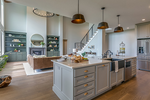 Kitchen island with gray and white colors staged for Tour