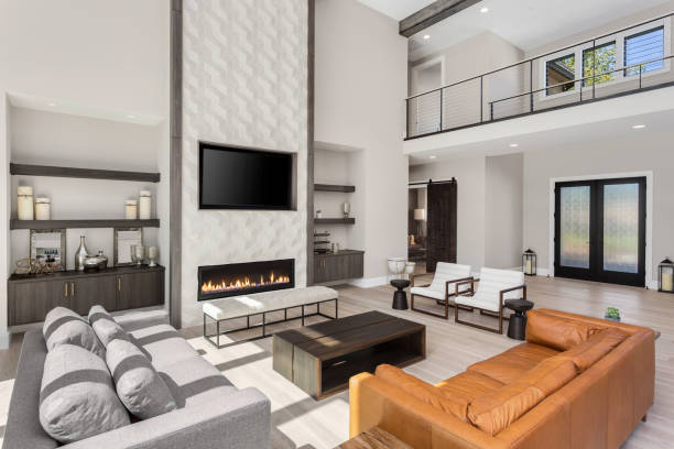Beautiful modern living room interior with hardwood floors and fireplace in new luxury home