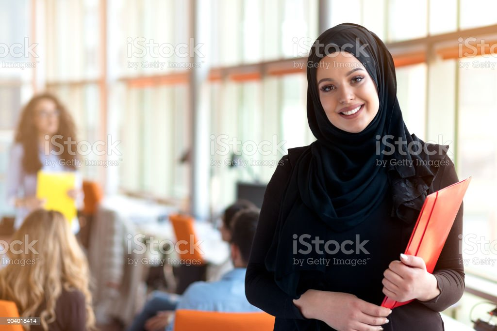 beautiful modern Muslim businesswoman portrait in office stock photo