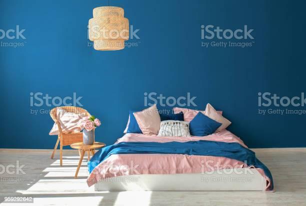 Beautiful modern room dark blue wall kingsize bed pink coverlet blue picture id959292642?b=1&k=6&m=959292642&s=612x612&h=mowbuoeka2aj6glh8tc1bxhzkqzmllxjqufkap01o6i=
