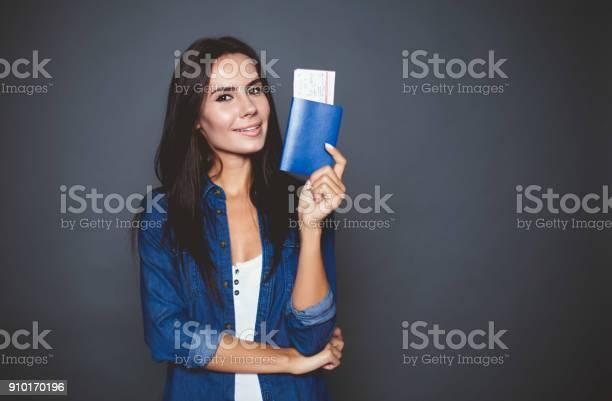Beautiful modern young woman with a passport and air tickets in her picture id910170196?b=1&k=6&m=910170196&s=612x612&h=vomgmqpjrvmrnax1u3k7r6rdygrqxrivkaofkxrllcc=