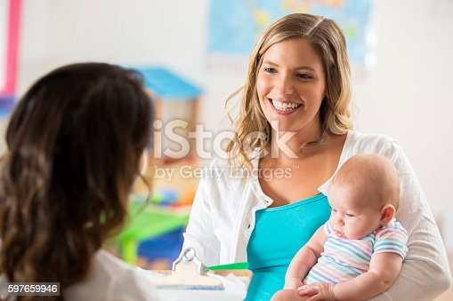 istock Beautiful mom and baby getting tour of a daycare center 597659946