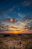 Beautiful morning desert landscape at sunrise with dunes.