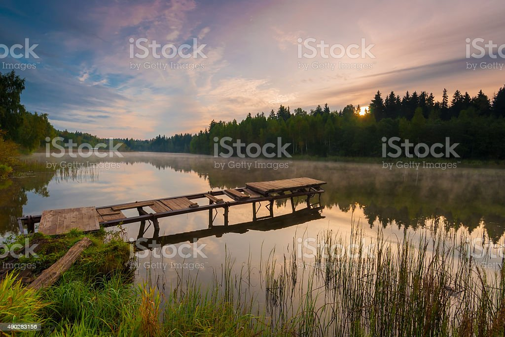 beautiful morning landscape with fog over the lake stock photo