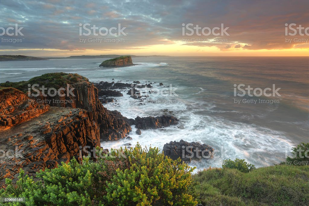 Beautiful morning with soft light on the rocks at Minamurra stock photo