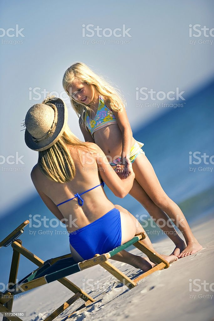 Beautiful Mother and Daughter At The Beach royalty-free stock photo