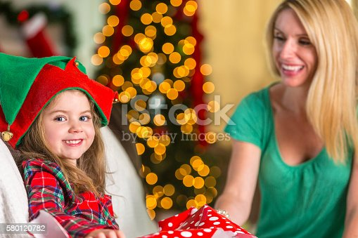 579124316 istock photo Beautiful mother and daughter enjoy Christmas morning 580120782