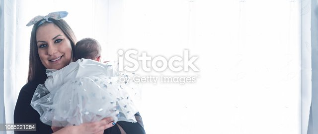 istock Beautiful mother holding her little newborn baby girl 1085221284