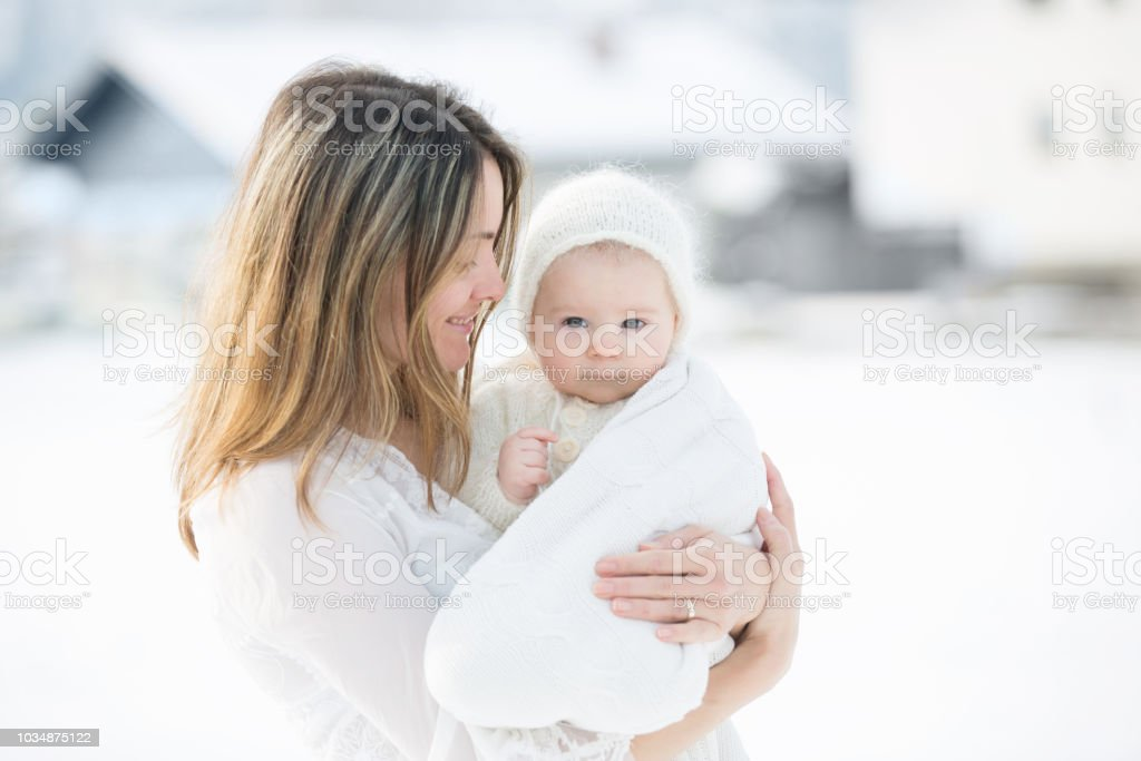 6e2ea1ce3d98 Beautiful Mother In White Dress And Cute Baby Boy In Knitted Onesie ...