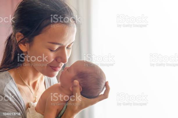 Beautiful mother kissing here little cute baby on her palm mother picture id1040213716?b=1&k=6&m=1040213716&s=612x612&h=dp8rehds5n0qbeaal3xonm2ntv9bhdnxgc6g1kkatda=