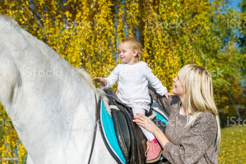 A Beautiful Mother Outdoors With Horse And Baby Daughter Horseback Stock Photo Download Image Now Istock