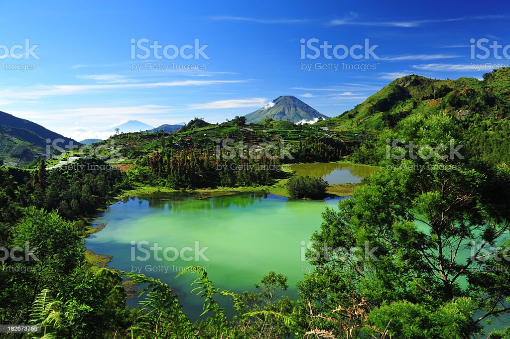 Beautiful mountain and forest landscape with a colorful lake stock photo