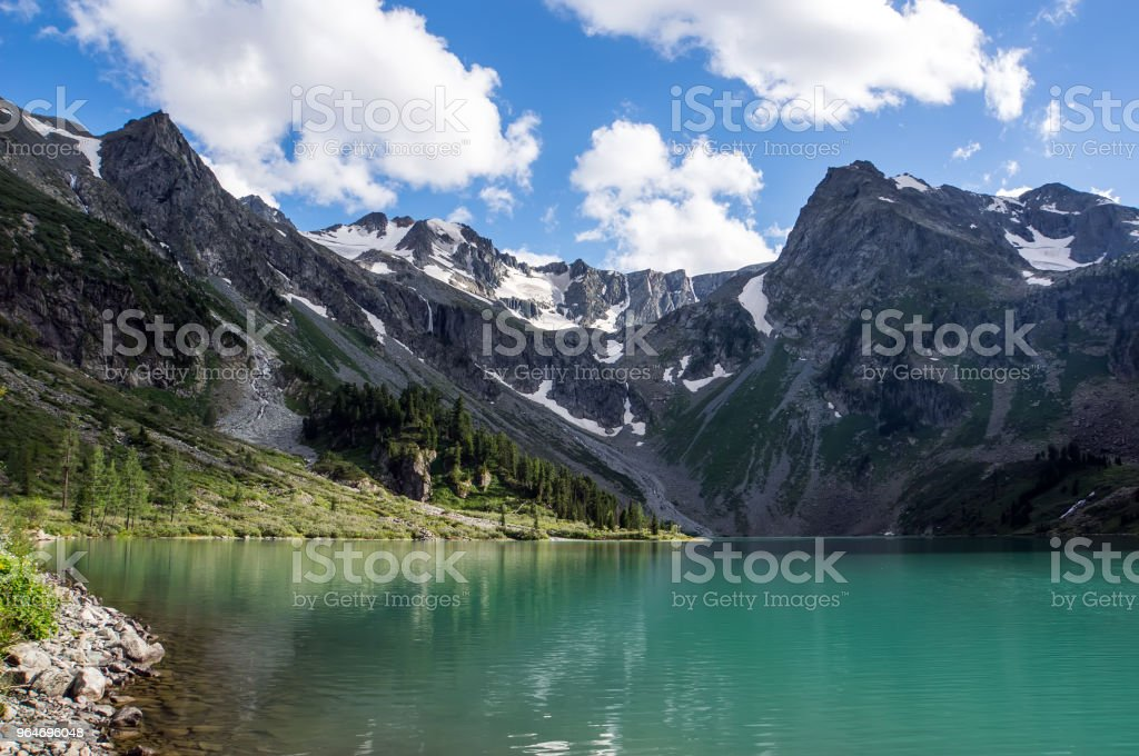Beautiful mountain lake with turquoise Multinskoe royalty-free stock photo