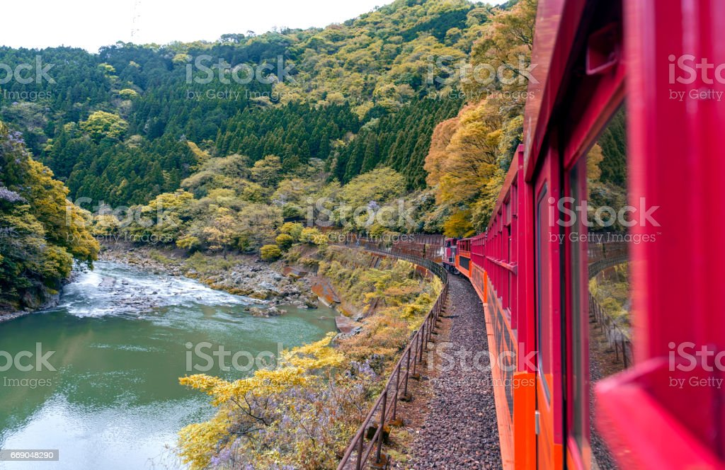 Beautiful mountain landscape and Hozu River seen from Sagano Scenic Railway or romantic train in Arashiyama, Japan stock photo