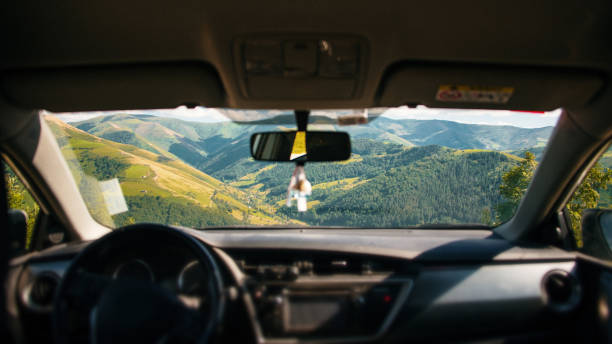 Beautiful mountain landscape as seen from inside a car stock photo