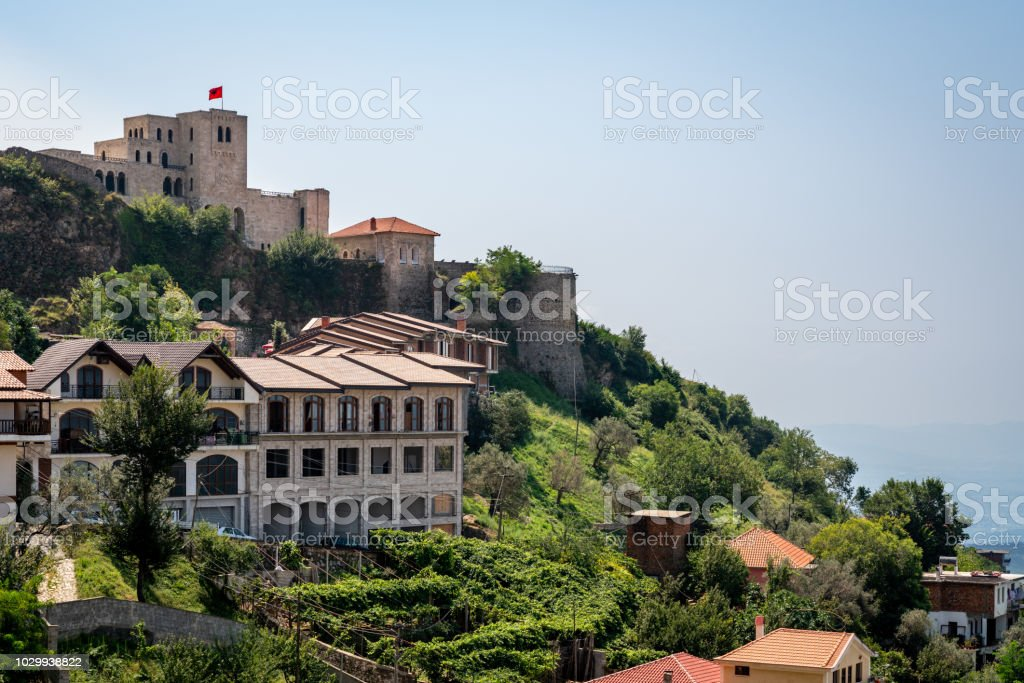 Beautiful mountain landscape view of ancient castle and buildings on green mountain side in Albania eastern Europe. stock photo