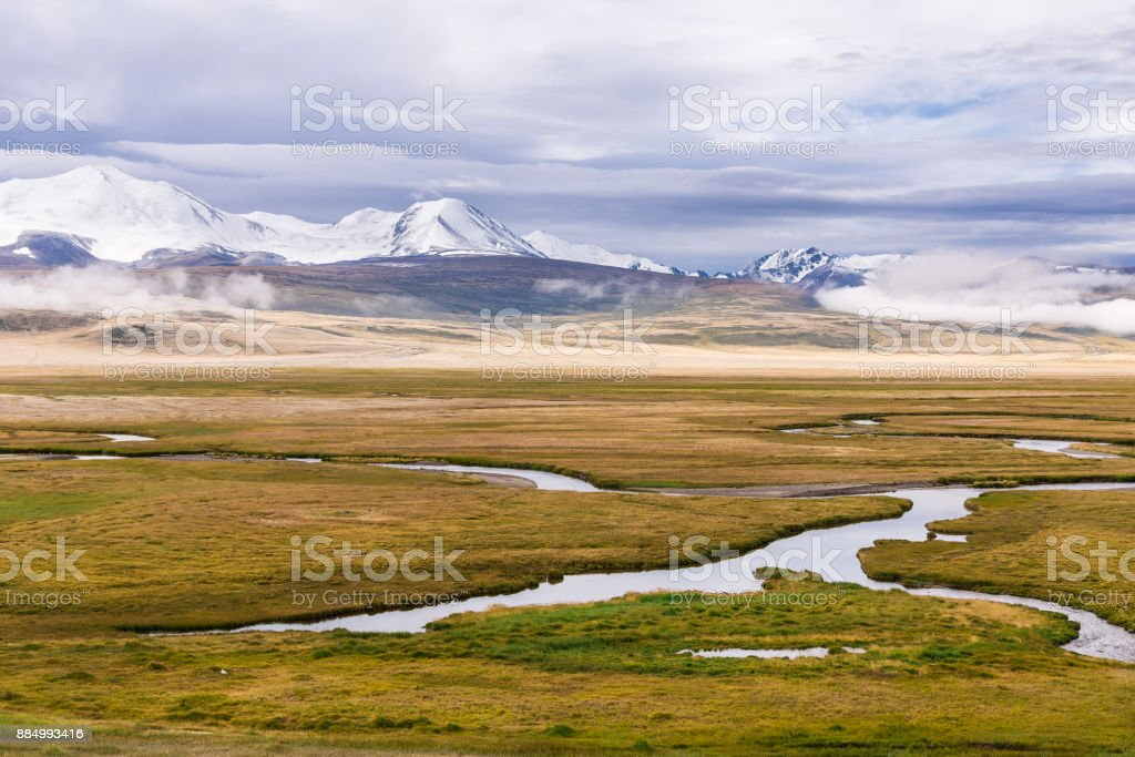 Beautiful mountain landscape with river  and cloudy sky. Plateau Ukok stock photo