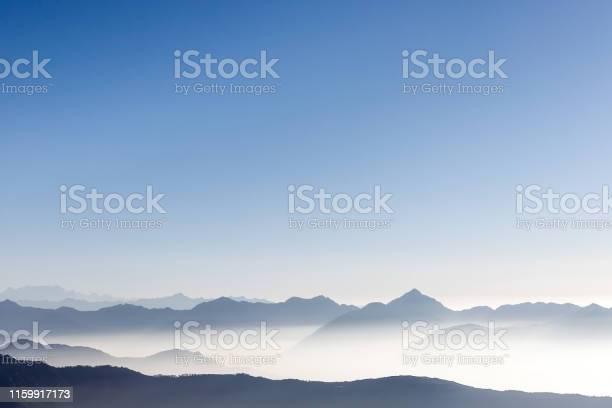 Beautiful mountain range background with blue sky and white mist in picture id1159917173?b=1&k=6&m=1159917173&s=612x612&h=n7abfi734m8e0czdxtx nxusmcxw3cylvwni33y5ri4=