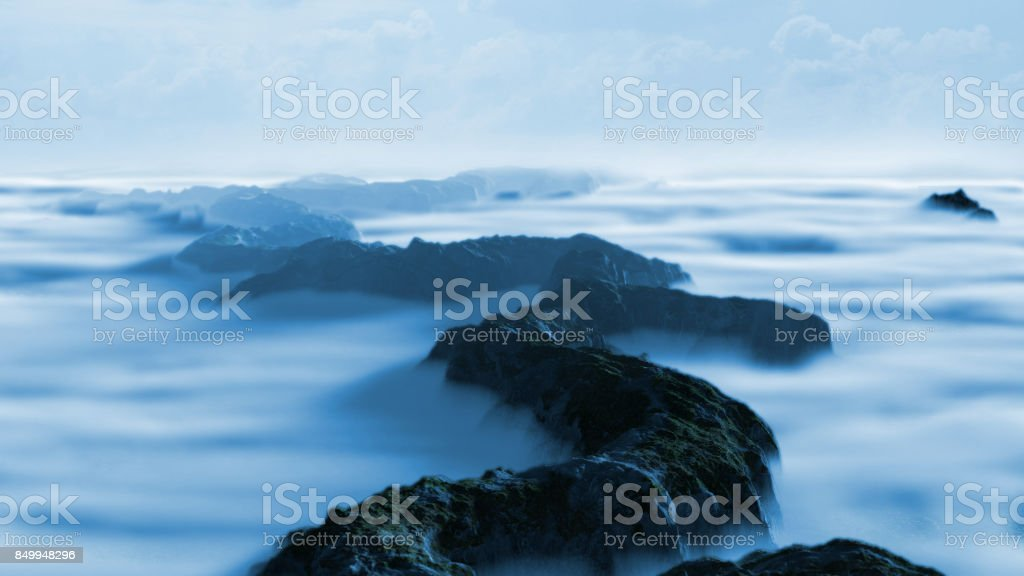 beautiful mountain range landscape with low crawling clouds stock photo