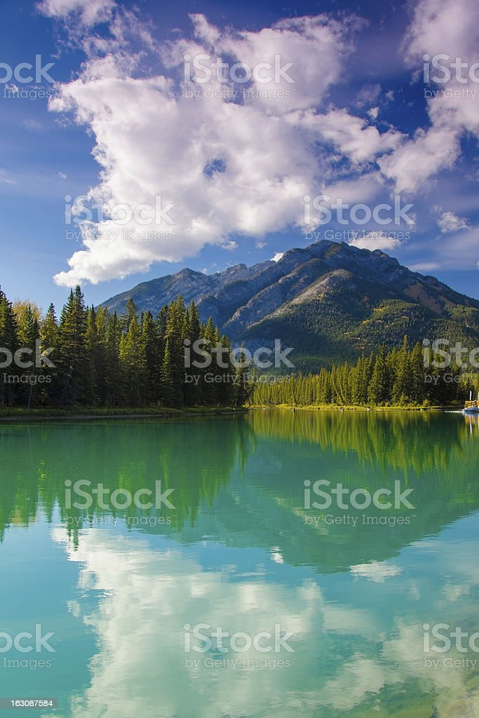 Beautiful mountain scenery reflected in river royalty-free stock photo