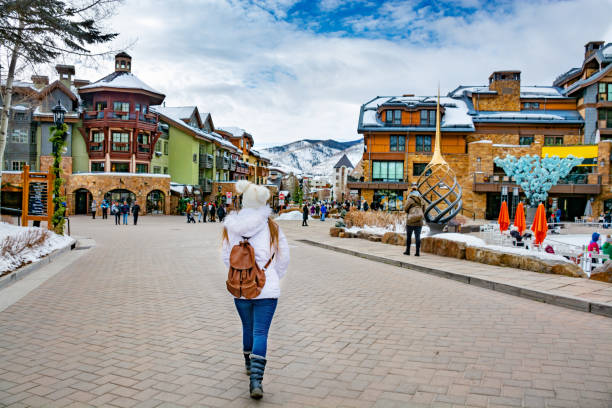 Beautiful mountain town in Colorado in winter. Vail, Colorado/USA-December, 30,2018. Vail village, small town at base of Vail Mountain, gateway for winter sports. People walking, stores and restarants, mountains in background. vail colorado stock pictures, royalty-free photos & images