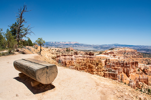 Beautiful mountain landscape. Empty wooden bench with desert view. Bryce Canyon National Park, Utah, USA