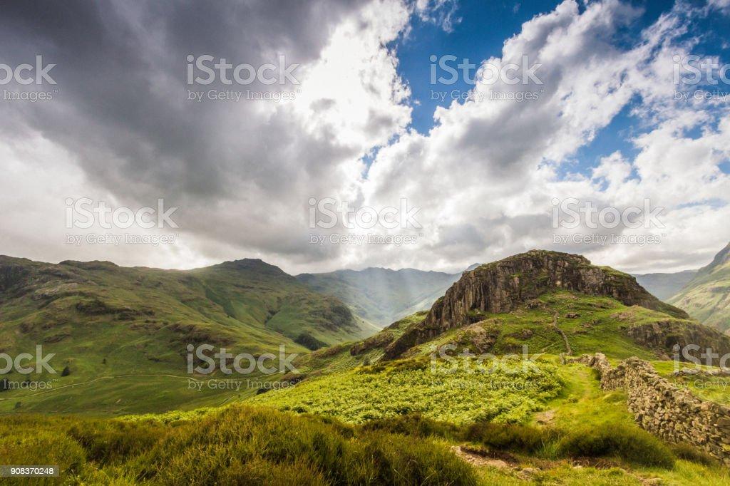 Beautiful mountain vista with sun beam shinning through the cloud stock photo