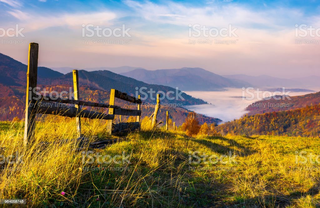 beautiful mountainous landscape with wooden fence stock photo