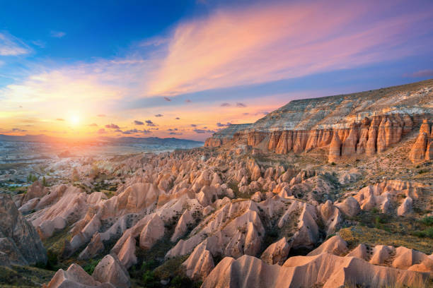Beautiful mountains and Red valley  at sunset in Goreme, Cappadocia in Turkey. stock photo
