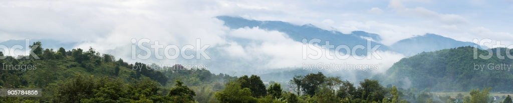 Beautiful mountains Range with clouds and fogs landscape on morning. stock photo