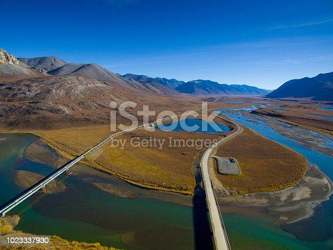 istock Beautiful mountains with oil pipeline, Alaska, USA 1023337930
