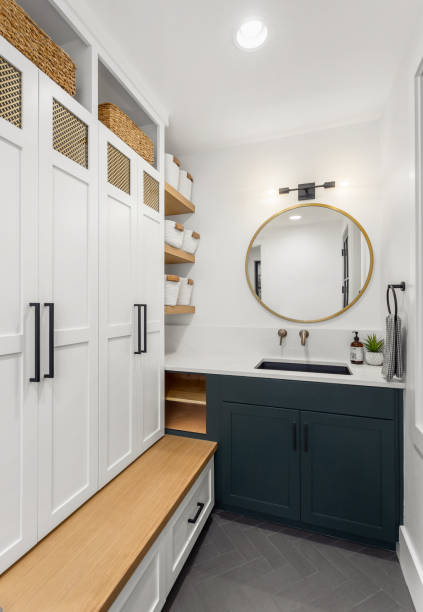 Beautiful mudroom interior in new luxury home with vanity, mirror, and cabinets