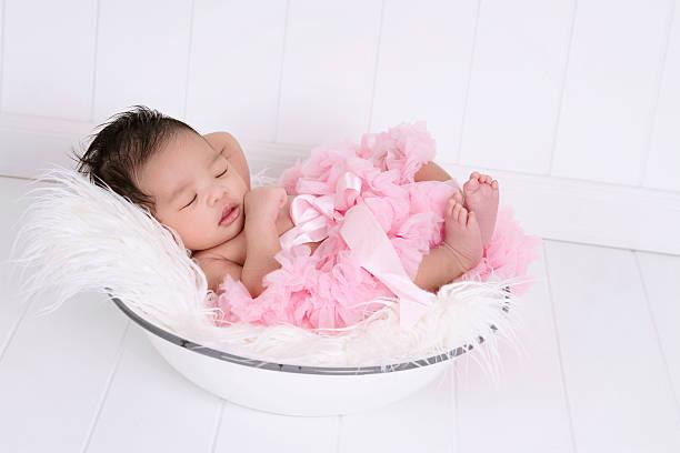 beautiful multi ethnic newborn wearing tutu - newborn baby girl stock photos and pictures