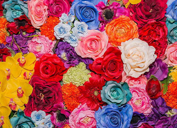 Beautiful multicolored artificial flowers background. - foto de stock