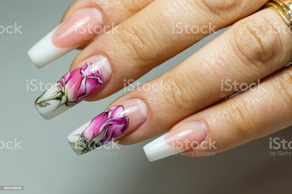 Beautiful multicolored flowers on a transparent lacquer on the nails...