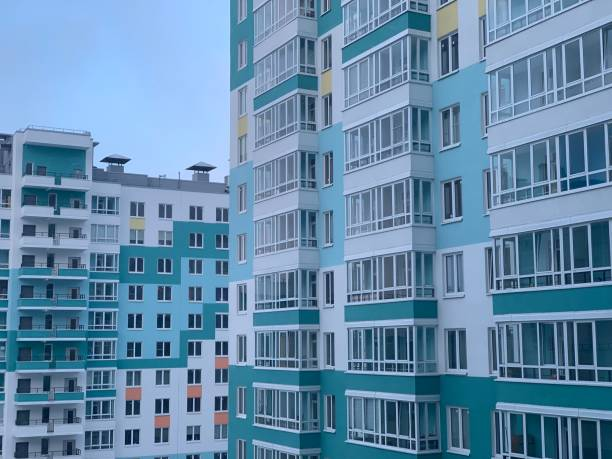 Beautiful multi-colored multi-storey residential building in a residential area. Beautiful multi-colored multi-storey residential building in a residential area. brics stock pictures, royalty-free photos & images